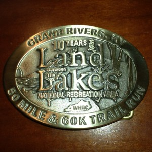 The belt buckle you are given for completing the 50 mile Land Between The Lakes Marathon (click to view larger)